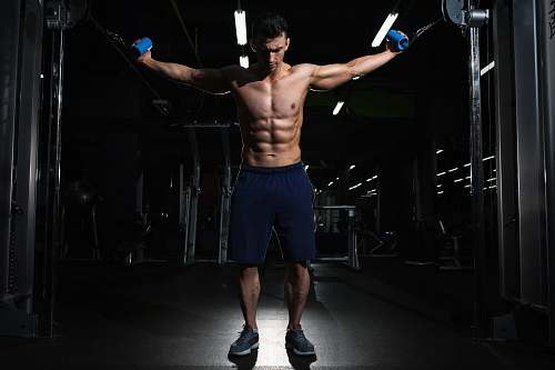 human man exercising inside dim room man