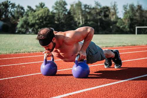 sport man exercising on field during daytime sports