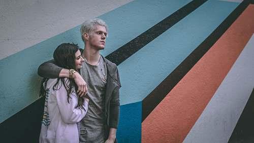 human man holding shoulder of woman tarmac