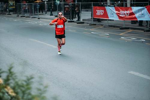 human man in red jersey running clothing