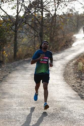human man running during daytime sport