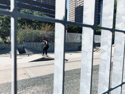 human man skateboarding asphalt
