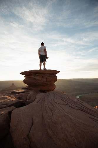human man standing on peak people