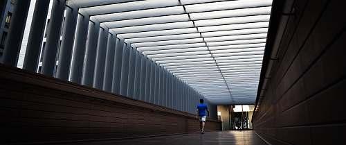 architecture man walking inside building dubai