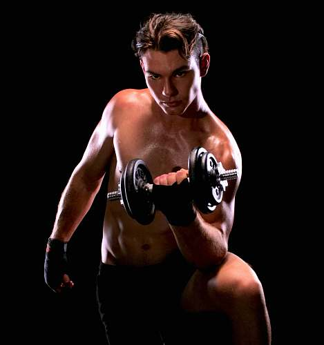 human man with black dumbbell close-up photography sport