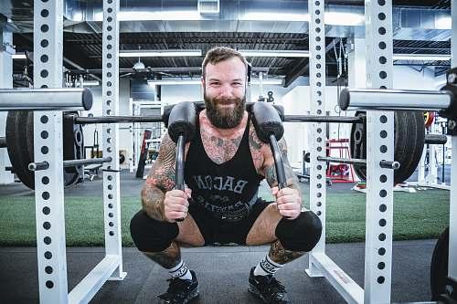 human men's black tank top and black shorts exercise
