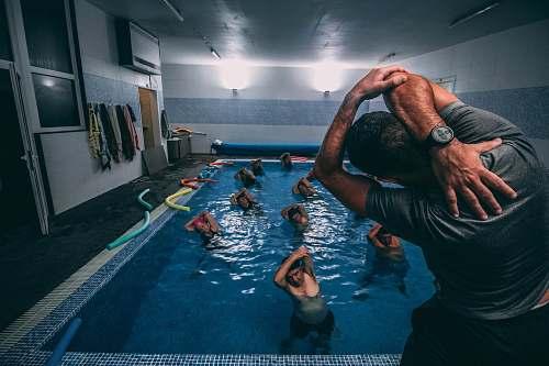 water people stretching inside pool room pool