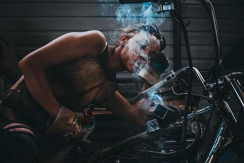 human person blowing smoke people