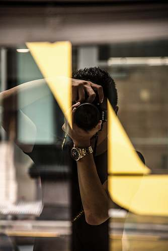 human person taking photo photographer