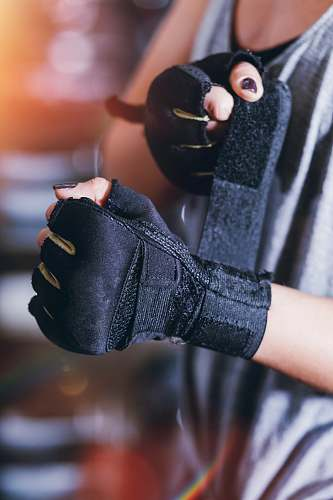 apparel person wearing black fingerless gloves clothing