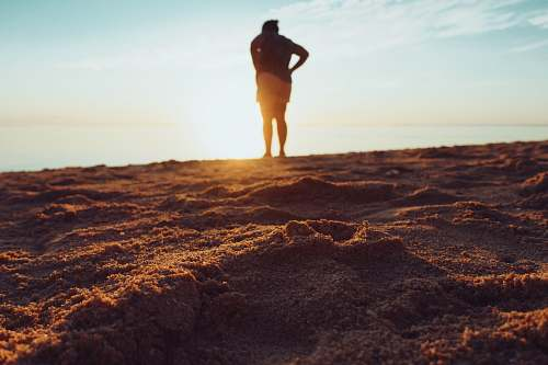 human standing person on brown sand mauritius