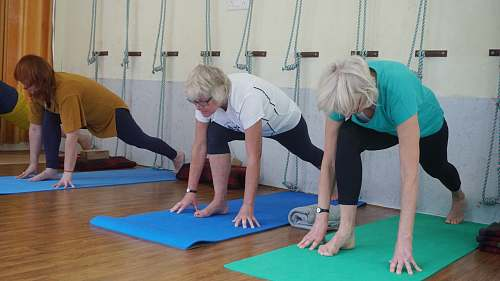 human three woman doing yoga inside room working out