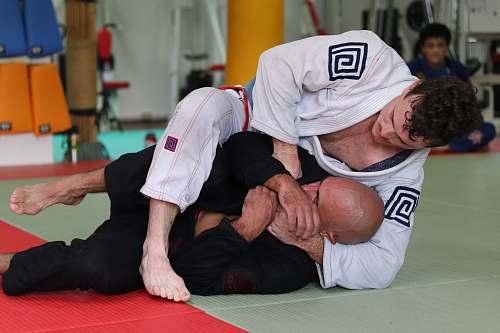 human two men doing jiu jutsu sport