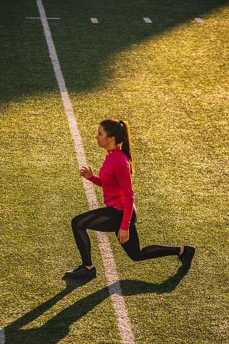 human woman bending on field sport