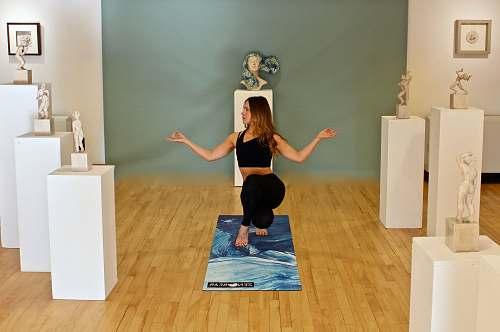 human woman doing yoga flooring