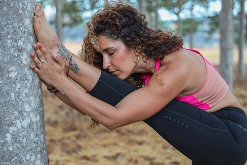 human woman doing yoga in forest skin