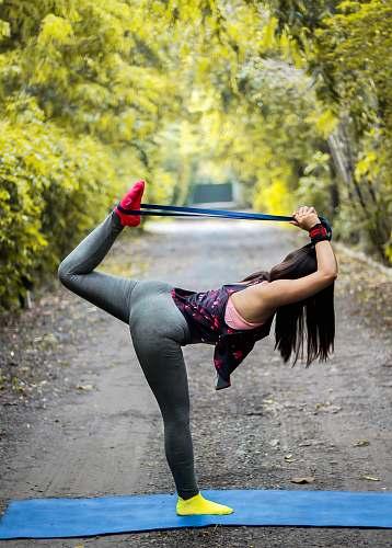 human woman doing yoga pose leisure activities