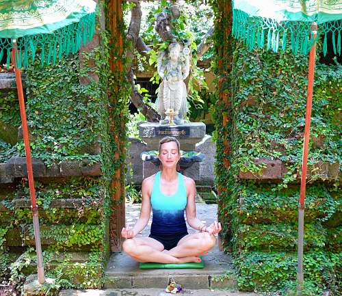 human woman dong yoga in a garden outdoors