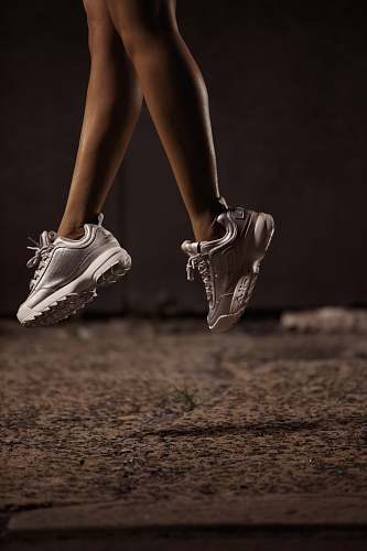 apparel woman jumps using white sneakers clothing