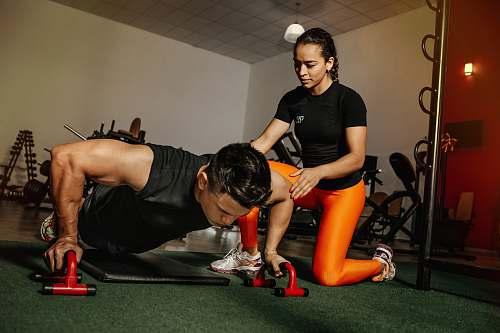 human woman kneeling beside man exercise