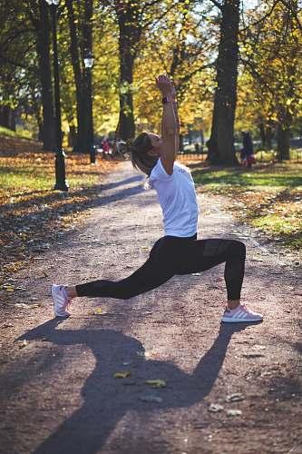 human woman stretching on pathway yoga