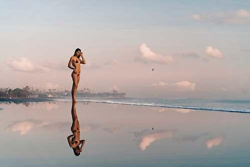 human woman wearing black bikini animal