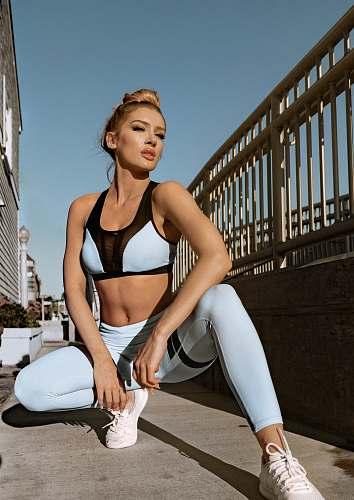 people woman wearing white sport bra and sweatpants human