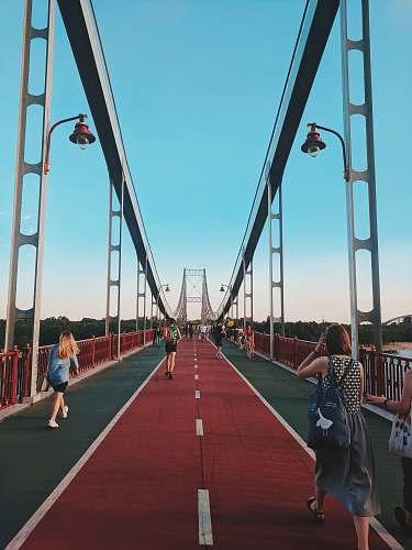 human women walking on bridge pishokhidnyi mist