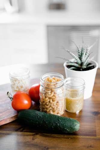 food green cucumber near jars on table vegetable