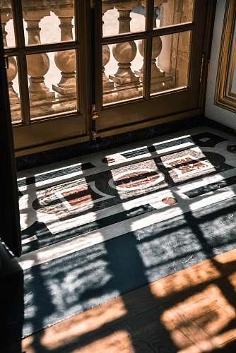 flooring white framed glass window during daytime interior design