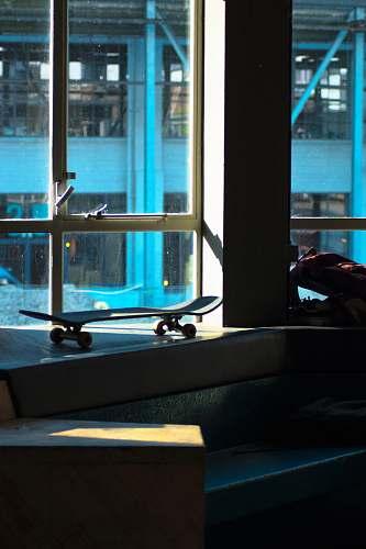 sport skateboard beside glass window sports