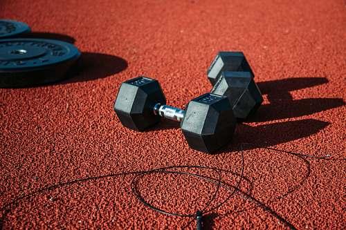 sphere pair of black dumbbells fitness