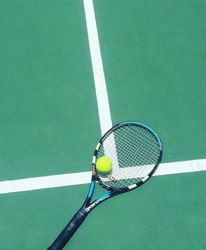 racket tennis racket and ball on field tennis racket