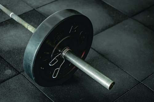 working out black barbell fitness