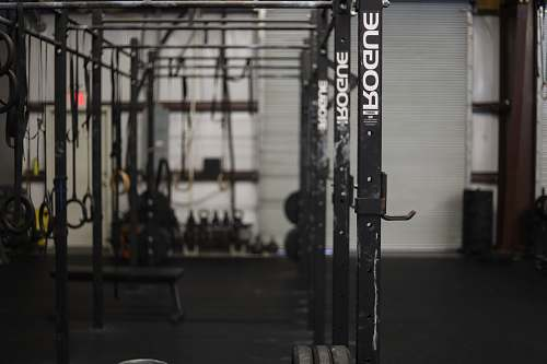 grey black exercise equipment working out