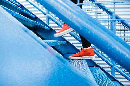 stairs person stepping on blue stairs red