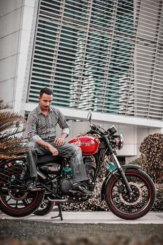 vehicle man sitting on motorcycle motorcycle