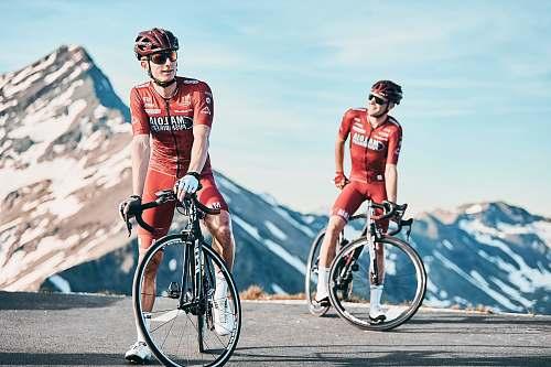 vehicle two men biking on road viewing mountain bicycle