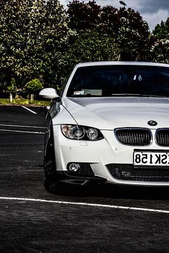 car white BMW car automobile