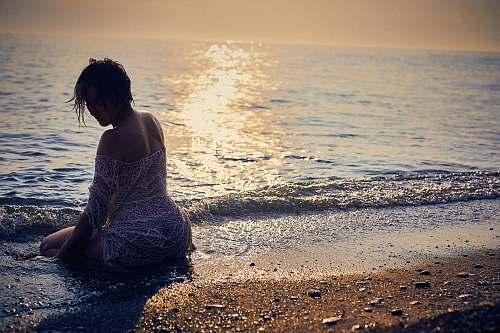 outdoors woman on seashore nature