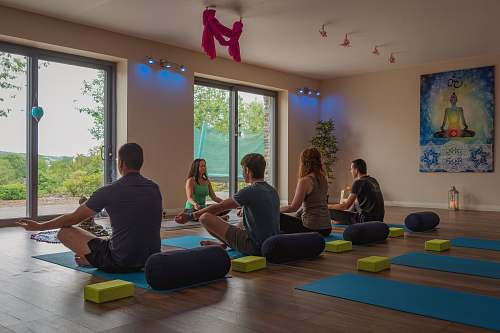 human people doing yoga inside room person