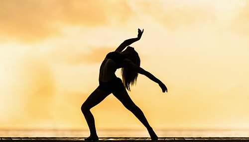dance silhouette of woman making yoga pose leisure activities