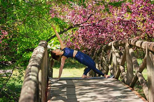 bridge woman on bridge doing exercise wooden
