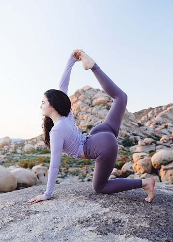 health woman stretching on tock calm